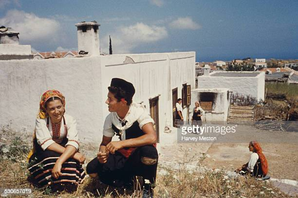 Inhabitants by their homes in the village of Embonas on the island of Rhodes Greece circa 1970