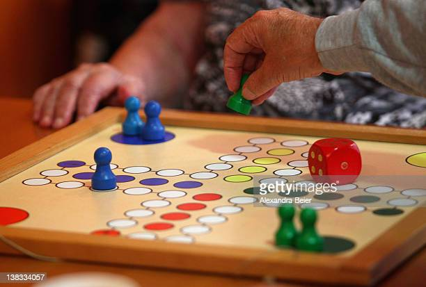 Inhabitants of a residential care home for Alzheimer's disease and dementia patients play ludo on November 15 2011 in Wolfratshausen Germany