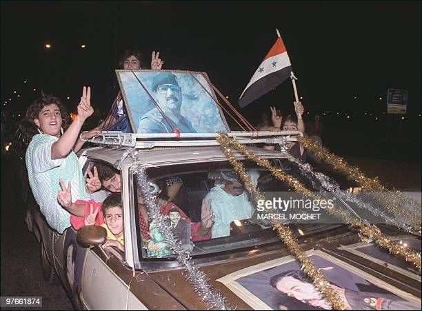 Inhabitants of Baghdad flash Victory Vsign 20 August 1988 in Baghdad as they celebrate the ceasefire between Iraq and Iran Iraq was at war with Iran...