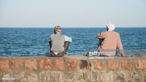 Inhabitants of Hormuz Island watching the sea, Persian Gulf, Hormozgan Province, Southern Iran