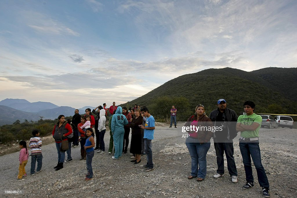 Inhabitants of Itubide, in Nuevo Leon state, Mexico wait for news in the area where a plane of the Mexican-American singer Jenni Rivera was crashed on December 09, 2012, close to Iturbide. The wreckage of a plane carrying star Mexican-American singer Jenni Rivera has been found in northern Mexico and there were no survivors, officials said. The Lear Jet was flying from south from Monterrey to Toluca, in the center of the country and was carrying six other people besides the singer, said Antonio Gonzalez, mayor of the town of Iturbide, near the crash site. AFP PHOTO / Julio Cesar Aguilar