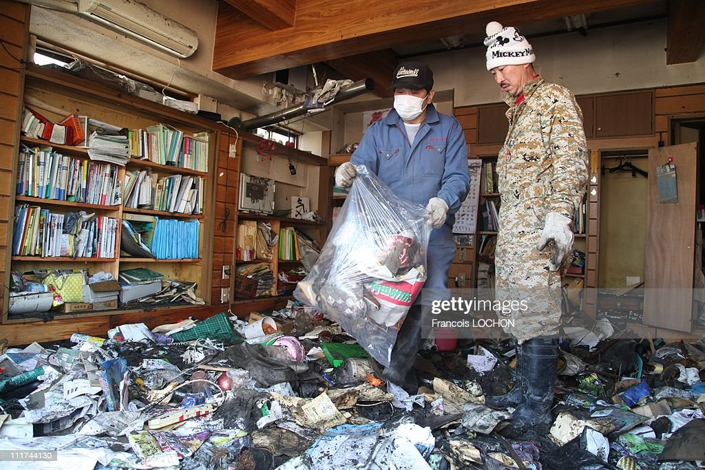 Inhabitants searching for the last few things to save from the rubble of their house destroyed by the earthquake on April 4,2011, in Rikusen Takata City,Japan. These objects are from the 30 000 victims of the earthquake that hit Japan on March 11, 2011 followed by an tsunami.