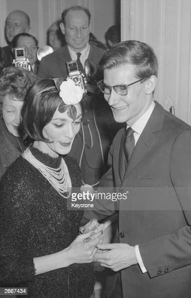 Inhouse designer Yves SaintLaurent with fashion house Christian Dior's main model Kouka at the presentation of Dior's haute couture Paris show