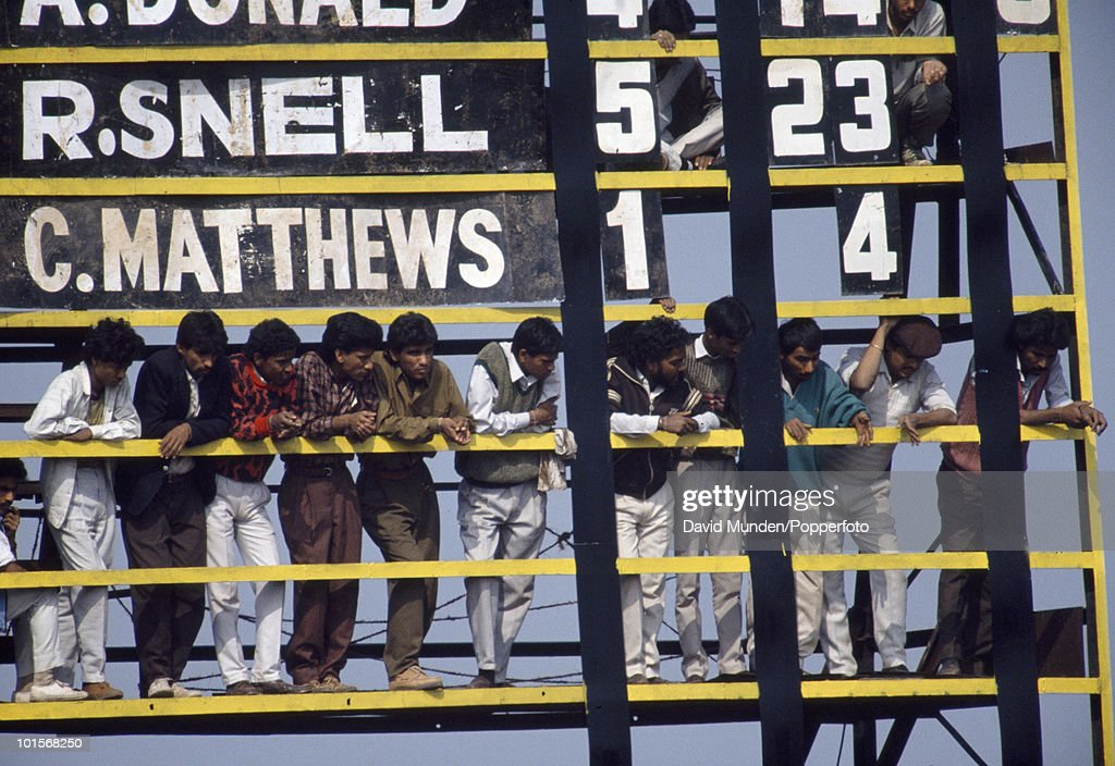 Inidan fans find a vantage point on the scoreboard during the 2nd One Day International match between India and South Africa at the Captain Roop Singh Stadium in Gwalior, India, 12th November 1991. India won by 38 runs.