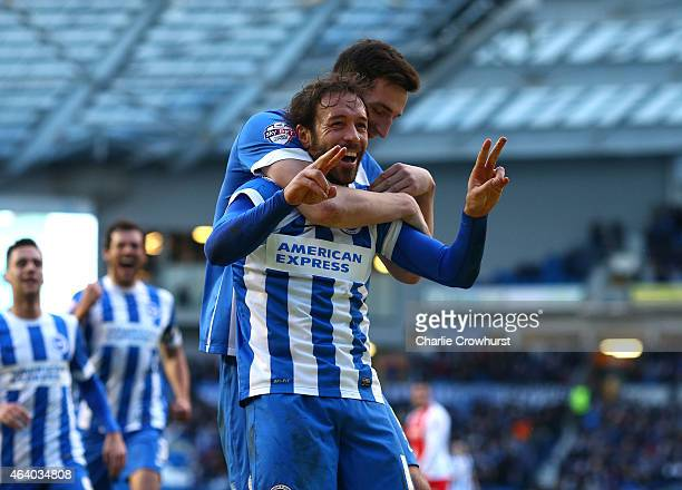 Inigo Calderon of Brighton celebrates with team mate Lewis Dunk after he scores his second and the team's fourth goal of the game during the Sky Bet...