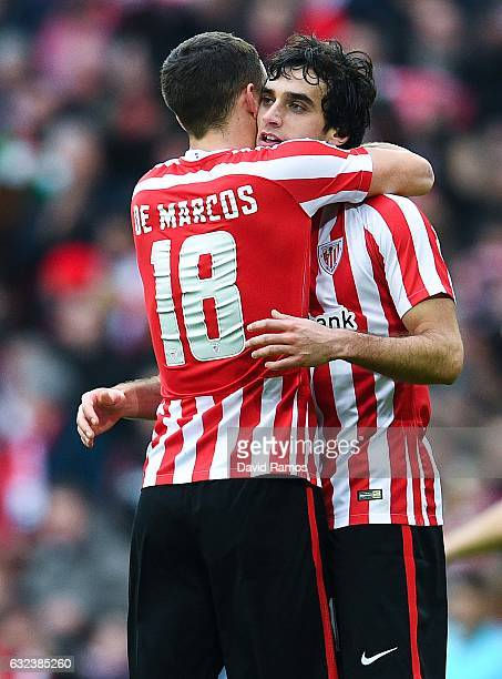 Inigo Lekue of Athletic Club celebrates with his team mate Oscar de Marcos after scoring his team's first goal during the La Liga match between...
