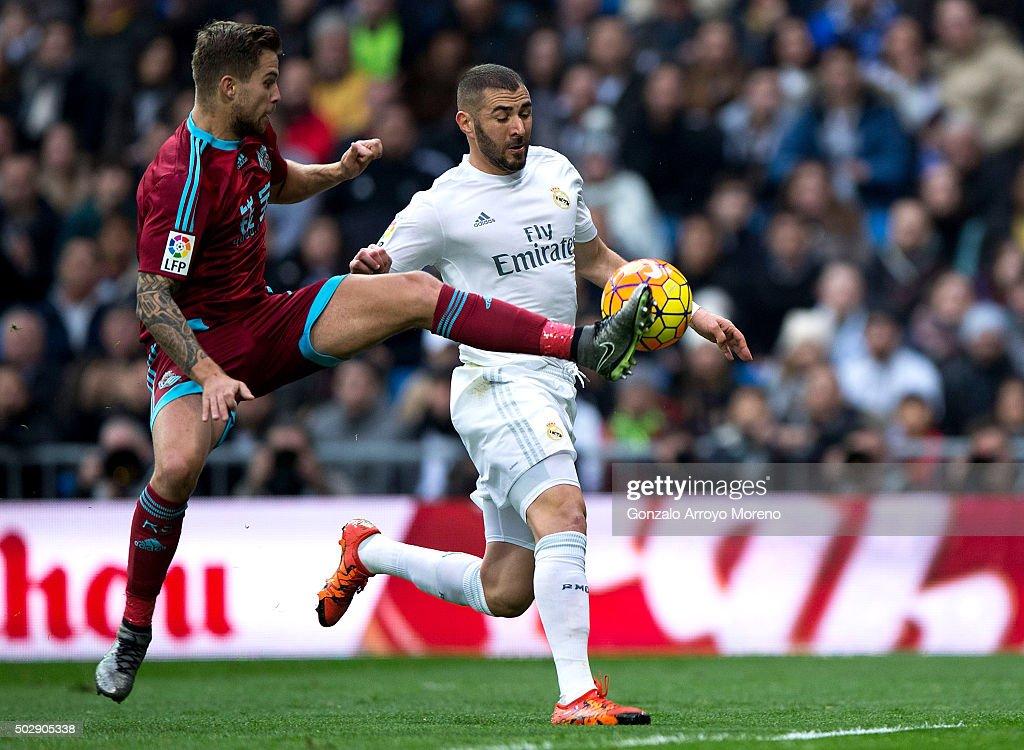 Inigo Martinez of Real Sociedad de Futbol blocks Karim Benzema of Real Madrid CF during the La Liga match between Real Madrid CF and Real Sociedad de...