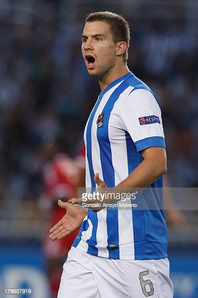 Inigo Martinez of Real Sociedad reacts during the UEFA Champions League Playoffs second leg match between Real Sociedad and Olympique Lyonnais at...