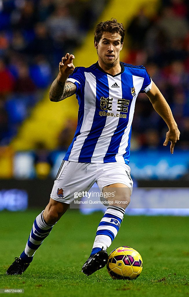 Inigo Martinez of Real Sociedad runs with the ball during the La Liga match between Levante UD and Real Sociedad de Futbol at Ciutat de Valencia on...