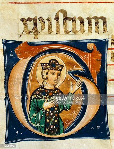 Initial capital letter G depicting the figure of a saint miniature from a medieval choral manuscript Latin manuscript 13th Century