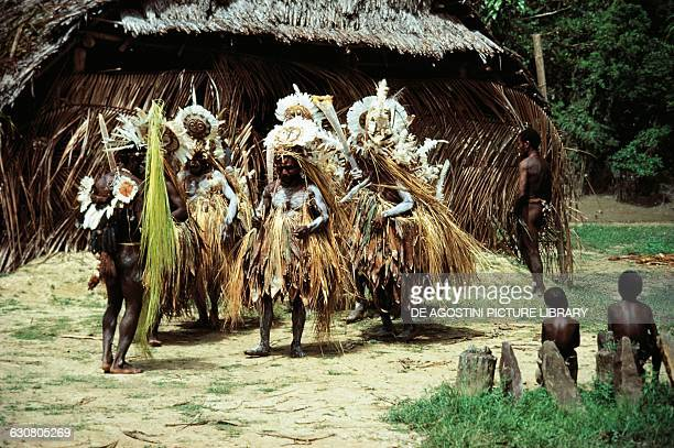 Initiatory dance with straw costumes tribe from the Karawari River Papua New Guinea