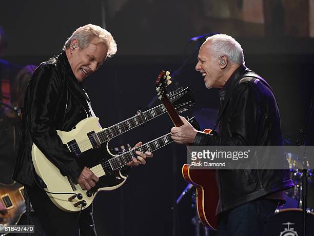 Injductee Don Felder is joined on stage by Peter Frampton during the Musicians Hall Of Fame 2016 Induction Ceremony show at Nashville Municipal...
