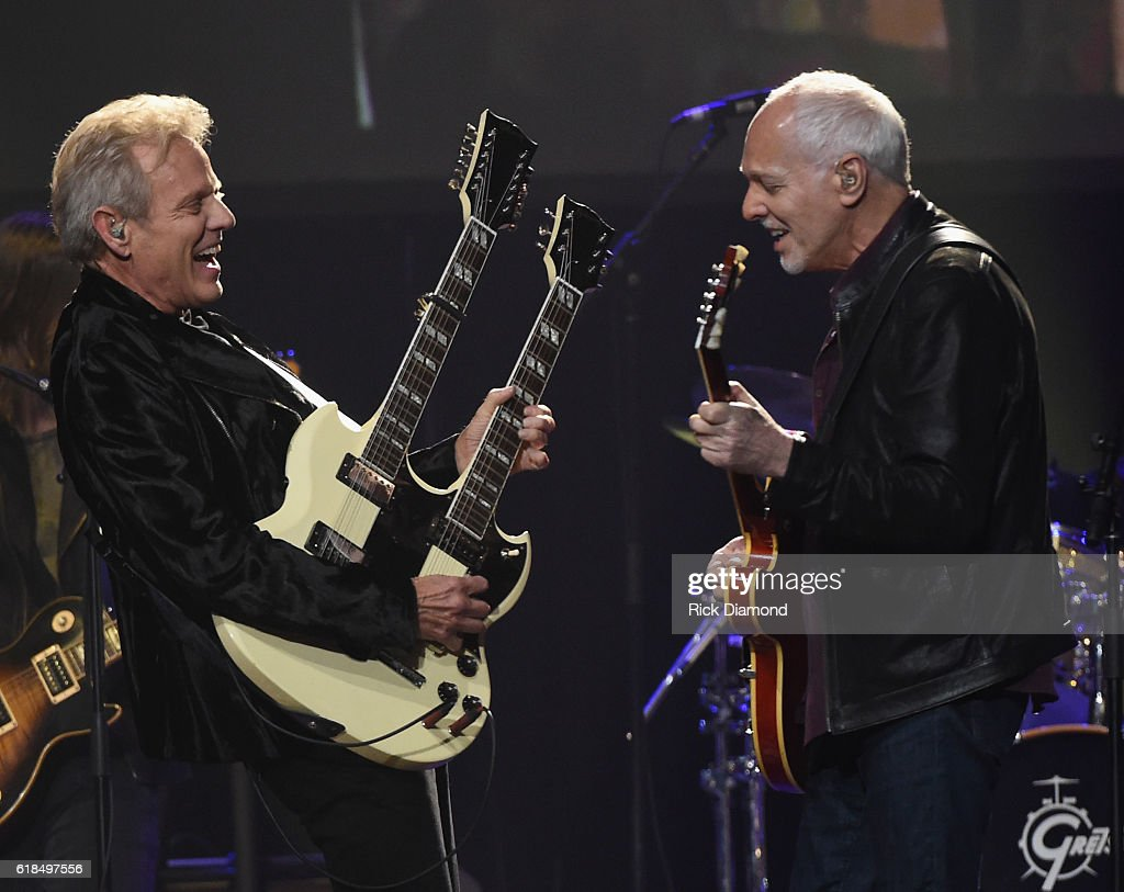 Injductee Don Felder is joined on stage by Peter Frampton during the Musicians Hall Of Fame 2016 Induction Ceremony & show at Nashville Municipal Auditorium on October 26, 2016 in Nashville, Tennessee.
