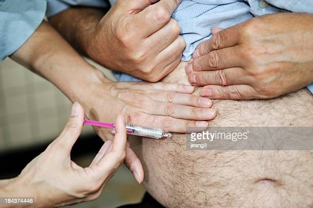 injecting a man's stomach
