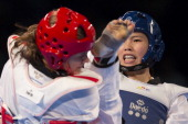InJong Lee of Korea competes with Casandra Ikonen of Sweden during the women«s 73 kg semifinal combat of WTF World Taekwondo Championships 2013 at...