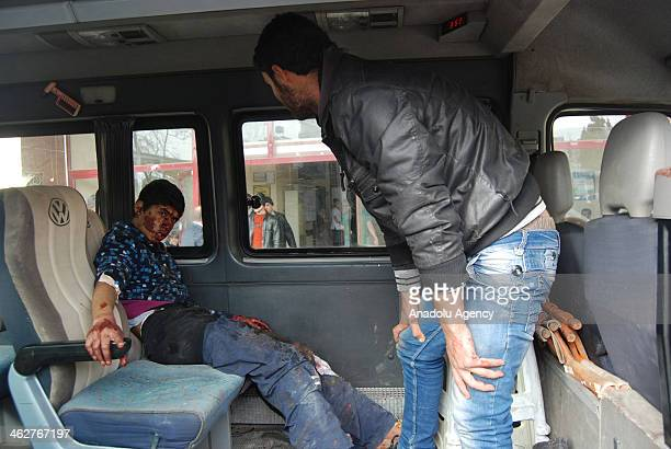 Injured 30 people in a car blast caused by explosionladen in Aleppo Syria are taken to the hospital in GaziantepTurkey on January 15 2014