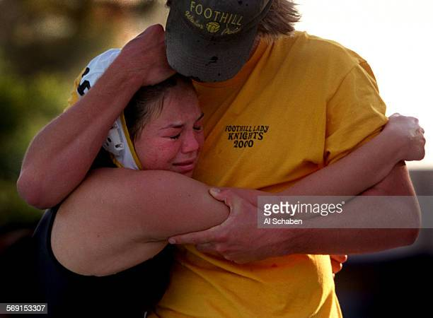Injured and overjoyed Foothill water polo player Brittany Hayes cries and hugs coach Dan Klatt after winning the Southern California Invitational...
