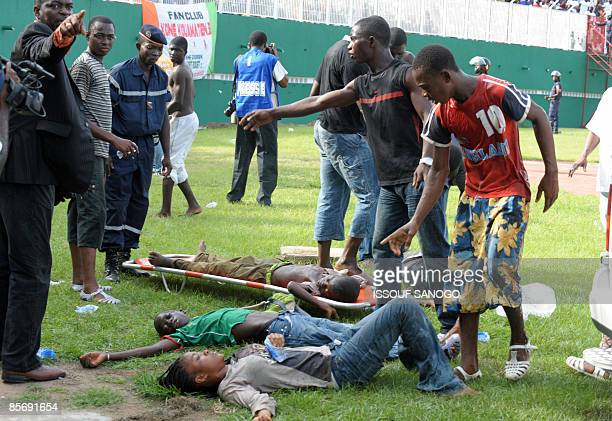 Injured are collected on March 29 2009 at Felix HouphouetBoigny stadium in Abidjan during the World Cup 2010 and African Cup of Nations qualification...