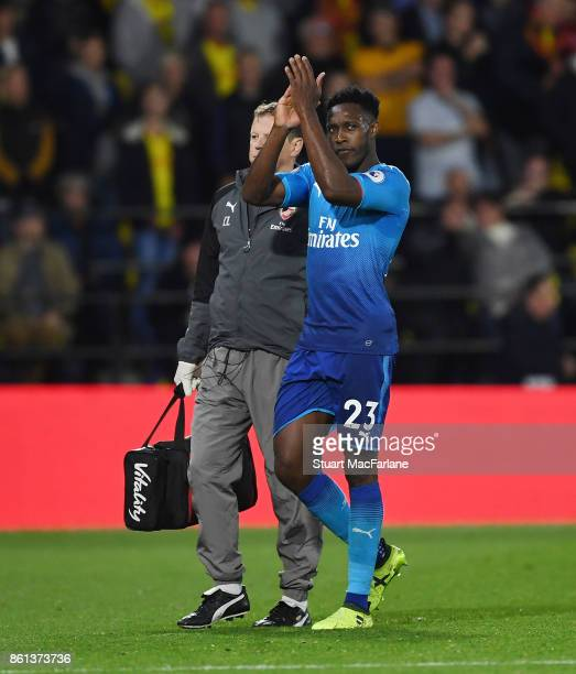 Injured Arsenal striker Danny Welbeck appluauds the Arsenal fans as he leaves the pitch during the Premier League match between Watford and Arsenal...