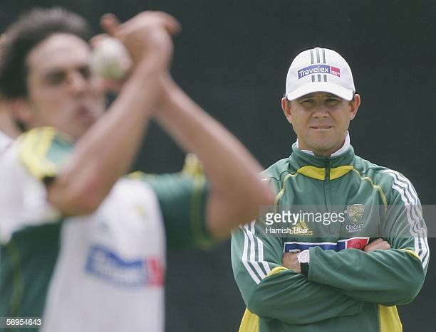 Injured Australian captain Ricky Ponting watches team mate Mitchell Johnson bowl during training at Newlands Cricket Ground on February 28 2006 in...