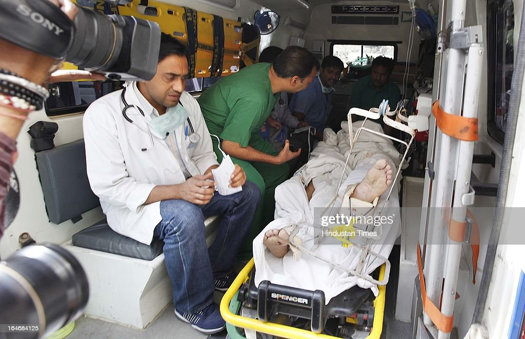Injured Bishan Singh carried in an ambulance as he is being shift from Deepak Memorial to GTB hospital after a man opened fire at 28 year old Nidhi and her father Bhishan singh(58) outside the karkardooma Metro station, on March 26, 2013 in New Delhi, India. Nidhi died on spot.