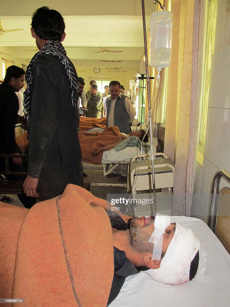 Injured blast victims rest at a hospital following a bomb explosion on the outskirts of Dera Ismail Khan in Khyber Pakhtunkhwa province on November 24, 2012. A bomb exploded near a Shiite religious procession in northwest Pakistan on November 24 killing seven people including four children, hospital officials said. The blast went off as people from the minority Shiite Muslim community were gathering to mark the anniversary of the death of the Prophet Mohammed's grandson Imam Hussain in 680. AFP PHOTO / STR