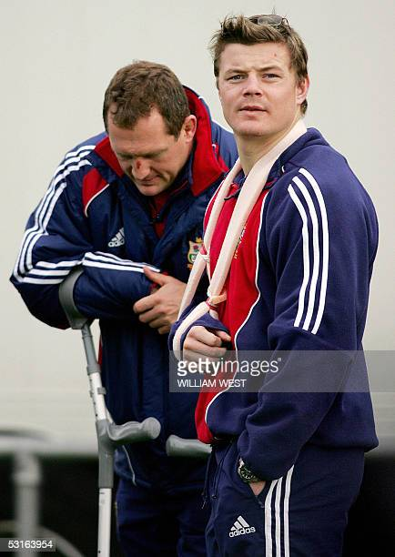 Injured British and Irish Lions players Brian O'Driscoll and Richard Hill look dejected as they watch their team's preparation for the next Test...