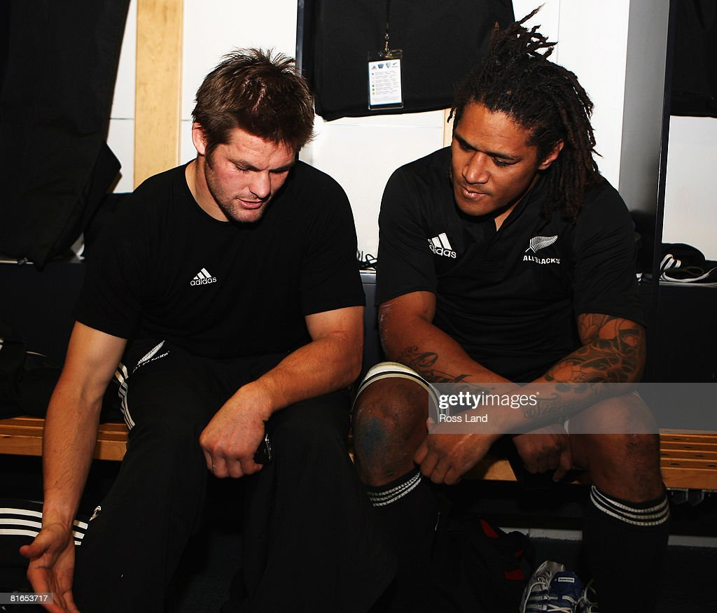 Injured captain Richie McCaw of the All Blacks sits in the dressing room with Rodney So'oialo following the second Iveco Series test match between...