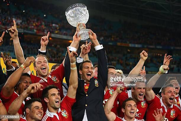 Injured captain Sam Warburton and Lions captain Alun Wyn Jones hold the Tom Richards Cup aloft after the Lions victory in the International Test...