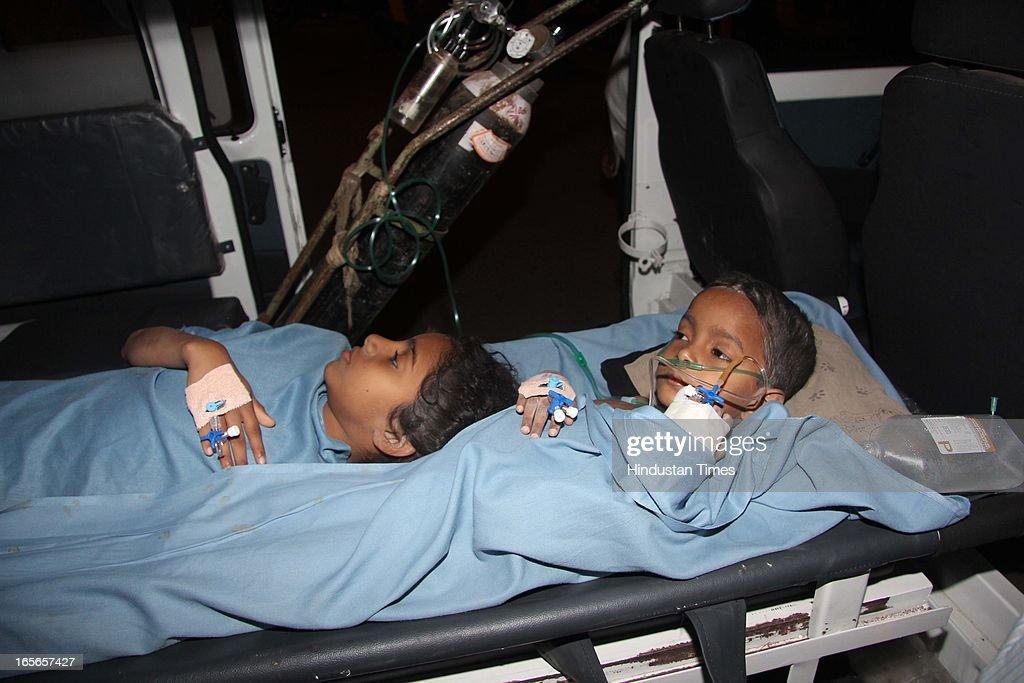 Injured children who survived the building collapse at Lucky compound getting treatment at Shivaji Hospital on April 5, 2013 in Thane, India. The death toll has risen to 39 while at least 69 people are injured. The building is illegal and constructed on Forest land. Police have registered a case against builders Salil and Khalil Jamadar under Section 304.