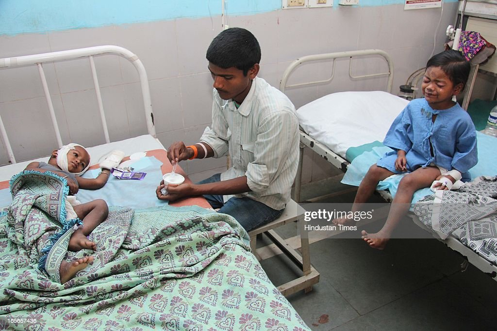 Injured children who survived the building collapse at Lucky compound admitted at Shivaji Hospital on April 5, 2013 in Thane, India. The death toll has risen to 39 while at least 69 people are injured. The building is illegal and constructed on Forest land. Police have registered a case against builders Salil and Khalil Jamadar under Section 304.