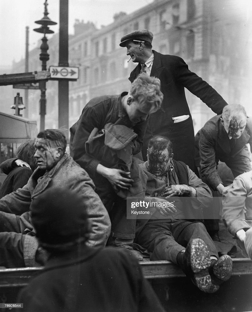 Injured civilians are assisted by rescue workers after a German V-2 rocket exploded in Farringdon Road in the City of London, 26th April 1945.