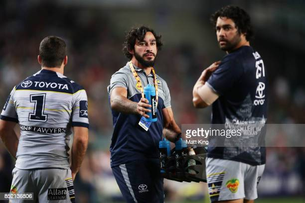 Injured Cowboys player Johnathan Thurston assists Cowboys warm up during the NRL Preliminary Final match between the Sydney Roosters and the North...