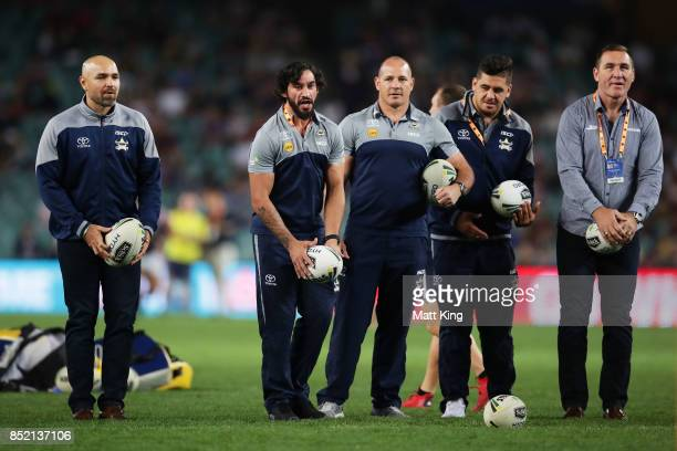 Injured Cowboys players Johnathan Thurston and Matt Scott assist Cowboys warm up during the NRL Preliminary Final match between the Sydney Roosters...