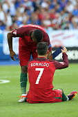 Injured Cristiano Ronaldo of Portugal gives the captain armband to Luis Nani during the UEFA Euro 2016 final match between Portugal and France at...
