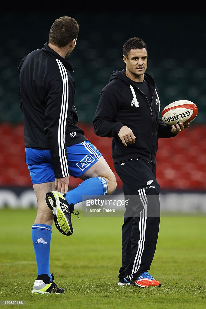 Injured Daniel Carter of the All Blacks talks to <a gi-track='captionPersonalityLinkClicked' href=/galleries/search?phrase=Kieran+Read&family=editorial&specificpeople=789465 ng-click='$event.stopPropagation()'>Kieran Read</a> during a captain's run at Millennium Stadium on November 23, 2012 in Cardiff, Wales.