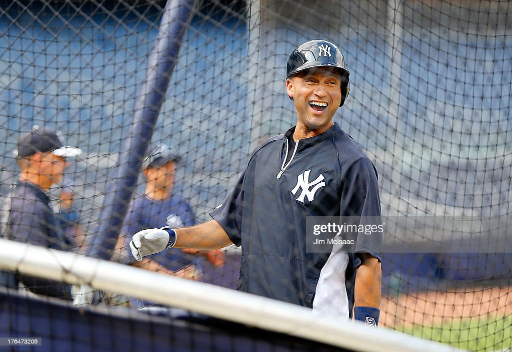 Injured <a gi-track='captionPersonalityLinkClicked' href=/galleries/search?phrase=Derek+Jeter&family=editorial&specificpeople=167125 ng-click='$event.stopPropagation()'>Derek Jeter</a> #2 of the New York Yankees has a laugh in the batting cage during practice before a game against the Los Angeles Angels of Anaheim at Yankee Stadium on August 13, 2013 in the Bronx borough of New York City.