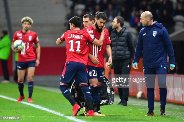 Injured Fares Bahlouli of Lille is replaced by Luiz Araujo of Lille during the Ligue 1 match between Lille OSC and AS SaintEtienne at Stade Pierre...