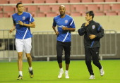 Injured French footballer Nicolas Anelka and Colombian midfielder Giovanni Moreno run with their fitness coach Santana Martel Luciano as their...