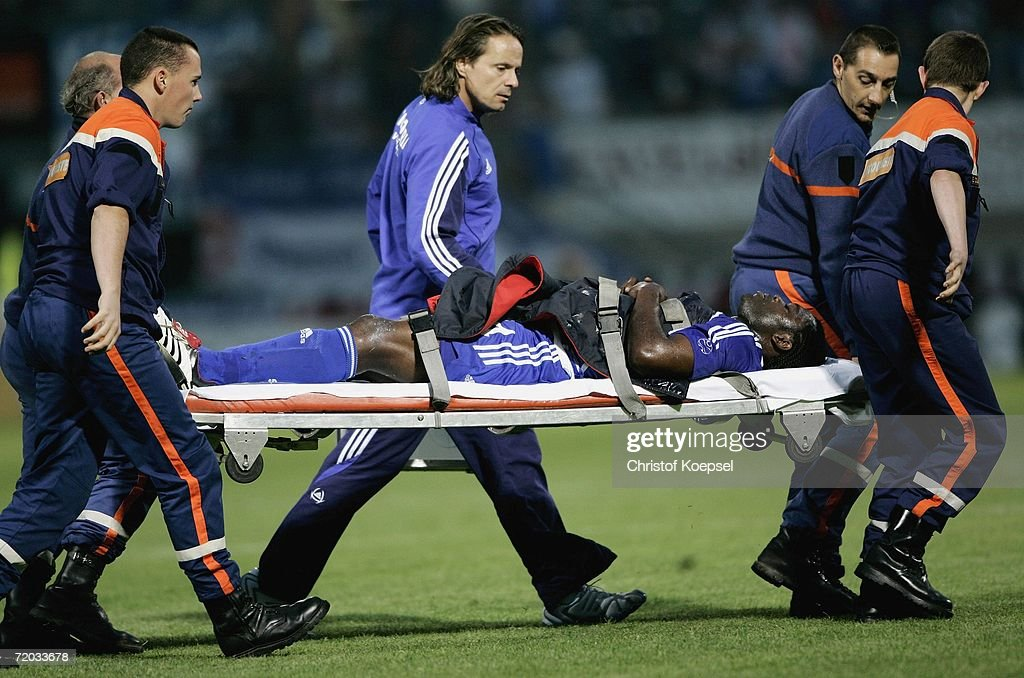 Injured Gerald Asamoah of Schalke is carried from the pitch during the UEFA Cup second leg match between AS Nancy and Schalke 04 at the Marcel Picot...