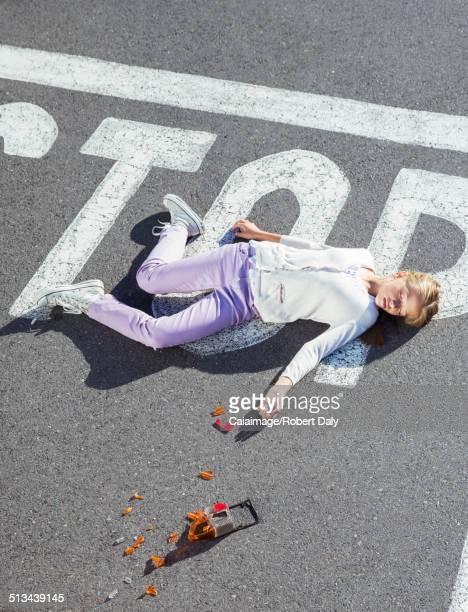 Injured girl laying in street