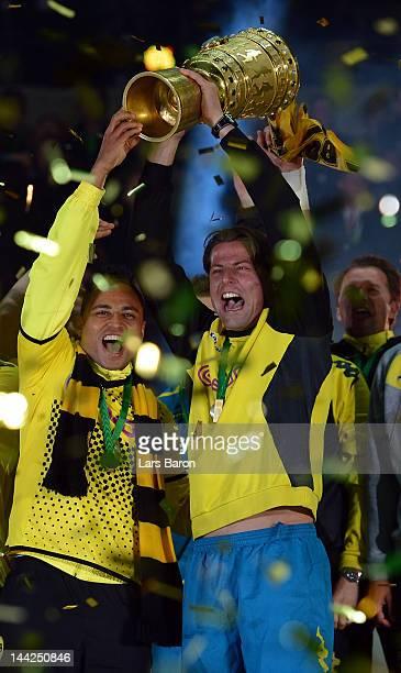 Injured goalkeeper Roman Weidenfeller of Dortmund celebrates with team mates winning the DFB Cup final match between Borussia Dortmund and FC Bayern...