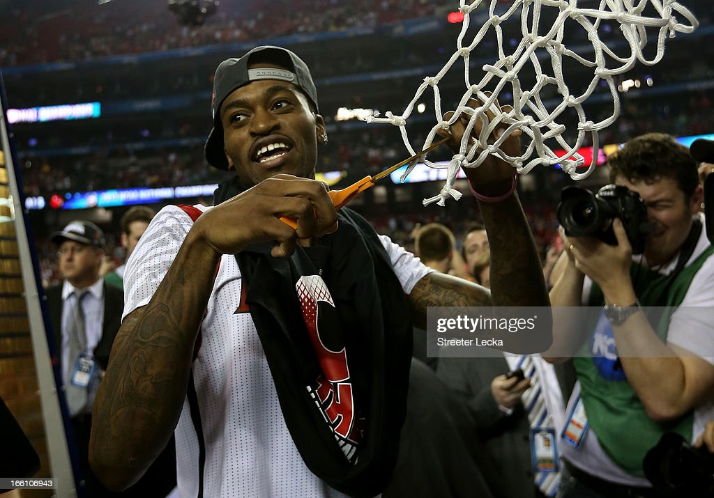 Injured guard Kevin Ware #5 of the Louisville Cardinals celebrates as he cuts down the net after Louisville won 82-76 against the Michigan Wolverines during the 2013 NCAA Men's Final Four Championship at the Georgia Dome on April 8, 2013 in Atlanta, Georgia.