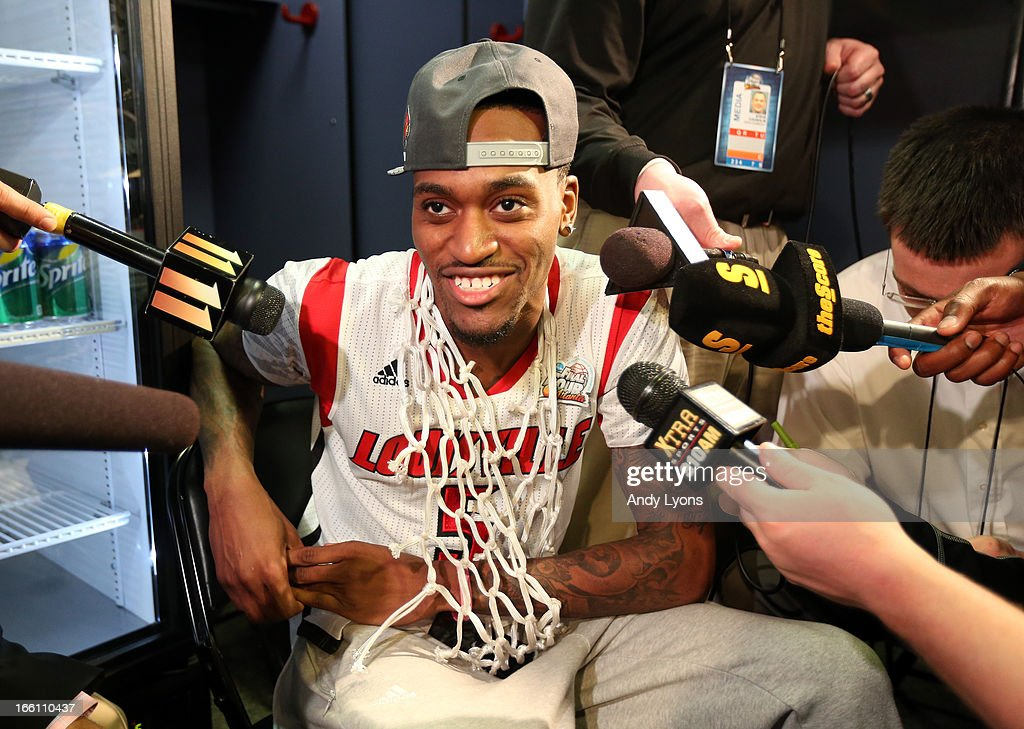 Injured guard Kevin Ware #5 of the Louisville Cardinals is interviewed in the locker room after Louisville won 82-76 against the Michigan Wolverines during the 2013 NCAA Men's Final Four Championship at the Georgia Dome on April 8, 2013 in Atlanta, Georgia.