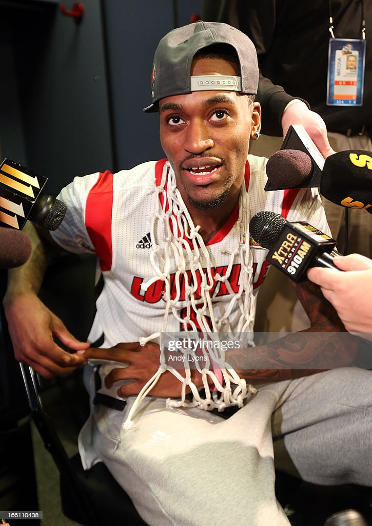 Injured guard Kevin Ware of the Louisville Cardinals is interviewed in the locker room after Louisville won 8276 against the Michigan Wolverines...
