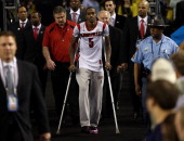 Injured guard Kevin Ware of the Louisville Cardinals walks out to the court against the Michigan Wolverines during the 2013 NCAA Men's Final Four...