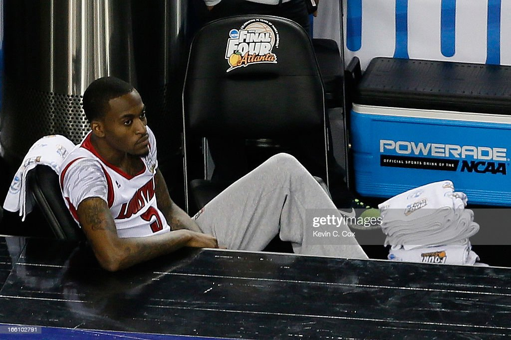 Injured guard Kevin Ware of the Louisville Cardinals watches his teammates playa against the Michigan Wolverines during the 2013 NCAA Men's Final...