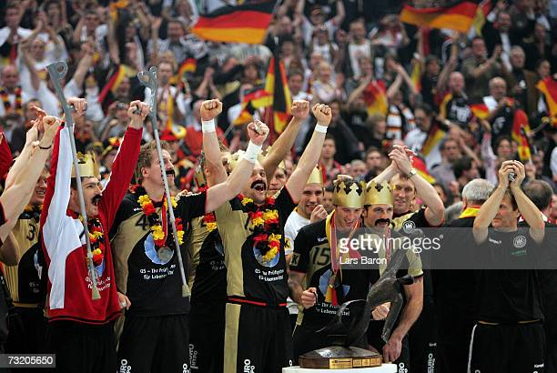 Injured HEnning Fritz celebrates with his team mates after winning the IHF World Championship final game between Germany and Poland at the Cologne...