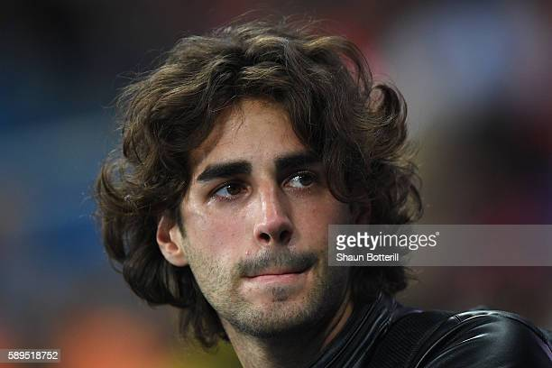 Injured high jumper Gianmarco Tamberi of Italy looks on during Men's High Jump qualification on Day 9 of the Rio 2016 Olympic Games at the Olympic...