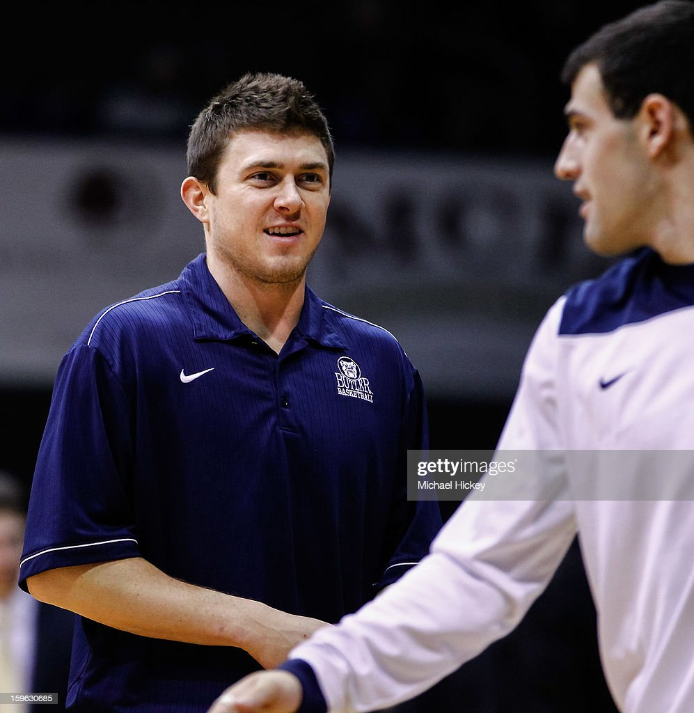 Injured high scorer Rotnei Clarke #15 of the Butler Bulldogs talks with Alex Barlow #3 of the Butler Bulldogs before the game against the Richmond Spiders at Hinkle Fieldhouse on January 16, 2013 in Indianapolis, Indiana. Butler defeated Richmond 62-47.